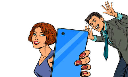 A woman takes a selfie with a man