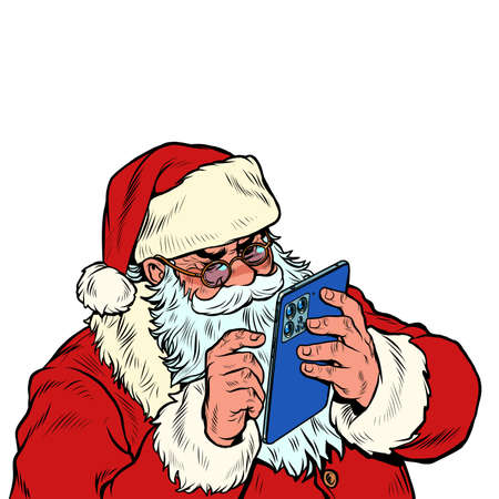 Santa Claus works on a mobile tablet. Christmas and New year