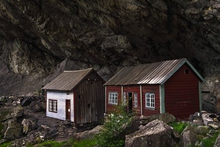 stoneage: The outdoor museum Helleren in the end of Jøssingfjord, in Sokndal municipality, in Rogaland county, Norway  Helleren is an old settlement that dates back to the stoneage, but the houses that stands today can be dated back to eighteenth century  Editorial