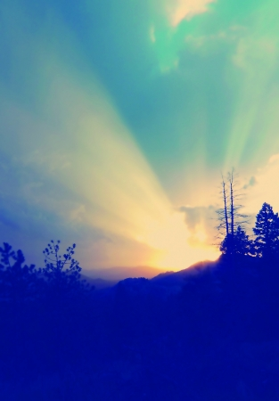 emanate: Radient sun rays emanate from a beautiful colorado camping sunset. Stock Photo