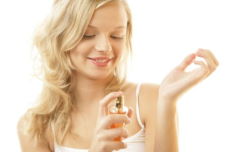 20 25 years old: Woman applying perfume Stock Photo