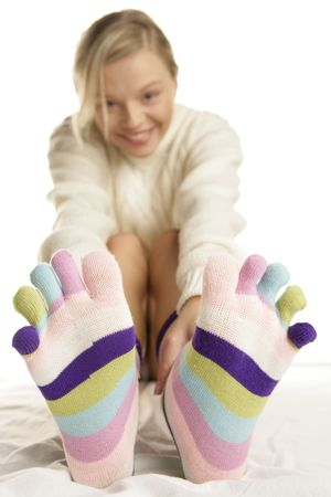 Young blonde woman wearing funny socks photo