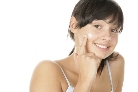 25 30 years old: Portrait of young attractive woman applying face cream isolated on white background