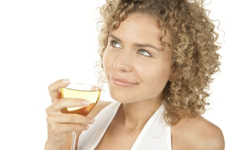 thirty���s: Young attractive curly haired woman drinking white wine isolated on white background