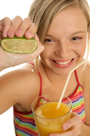 Portrait of young smiling woman squeezing lime Stock Photo - 5102040