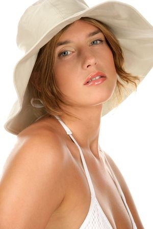 Portrait of young woman wearing bikini and hat isolated on white background photo