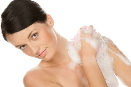 Portrait of young woman washing her body isolated on white background