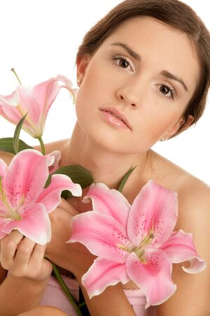 20 25 years old: Portrait of young beauty woman with lilies isolated on white background