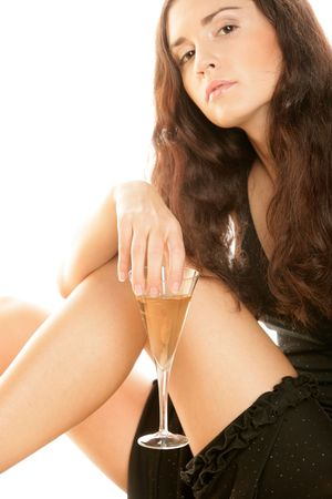 Young woman wearing black dress with glass of champagne isolated on white background photo
