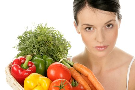 Portrait of young woman with basket with vegetables isolated on white background photo