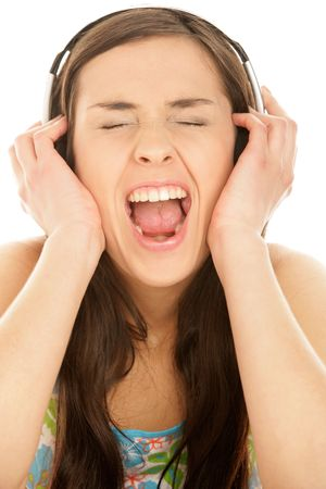 Portrait of young woman listening music and screaming photo