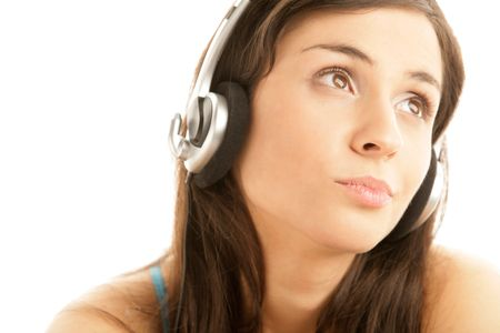 Portrait of young woman wearing headset and listening music isolated on white background photo