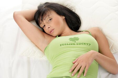 nightgown: Young beauty sexy woman lying down resting her head on hand