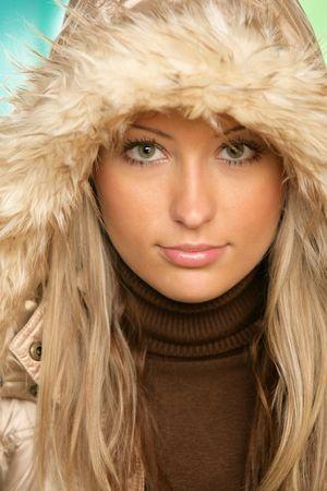 Portrait of young beauty woman wearing fur hood