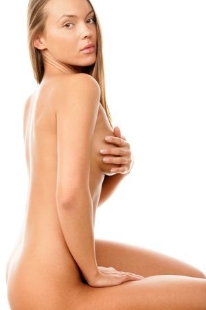Young beauty naked woman covering her breast photo