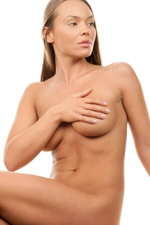 Young beauty naked woman covering her breast Stock Photo
