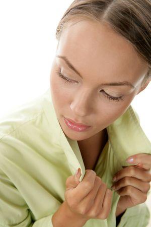Closeup portrait of young woman wearing green coat photo