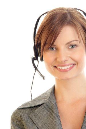 Portrait of friendly secretary/telephone operator wearing headset