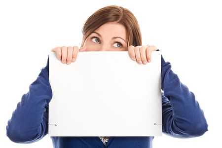 Portrait of beautiful worried woman covering face with blank notecard Stock Photo