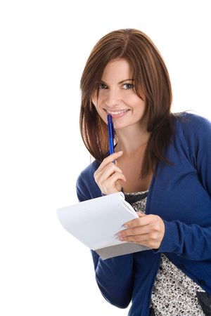 Young woman does records by pen in notepad photo