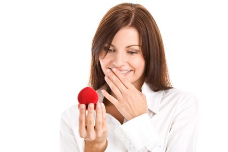 Happy woman holding box with engagement ring smiling