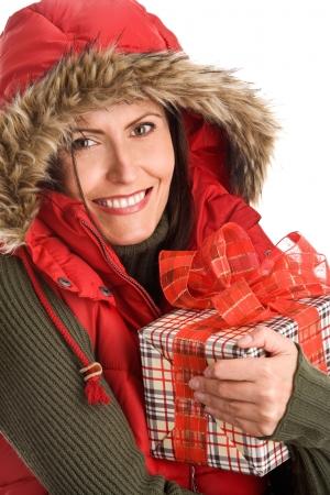 Portrait of mature beautiful woman holding gift photo
