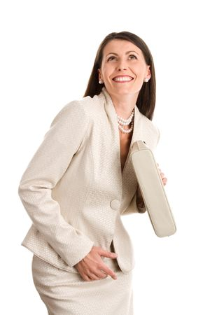 skirt suit: Portrait of mature elegant woman looking up smiling