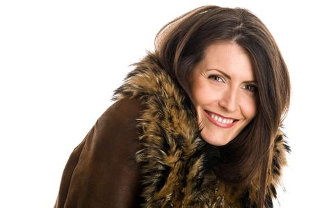 sheepskin: Retrato de mujer atractiva con piel de oveja sonriendo Foto de archivo