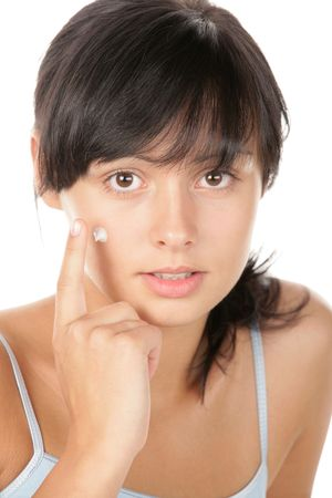 anti bacterial: Teenage girl applying facial cream