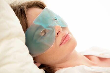 Woman wearing eye mask photo