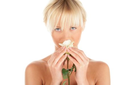 Woman with white rose. Focus on rose and hands