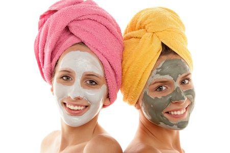 Two teenage girls wearing facial cream photo