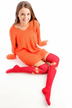 girl socks: Funny young woman sitting isolated white background