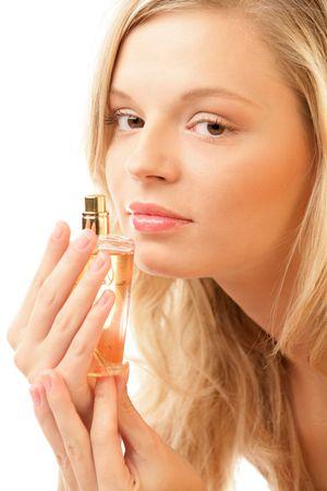 Woman smelling perfume photo