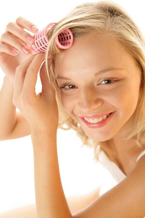 curlers: Young woman with hair roller