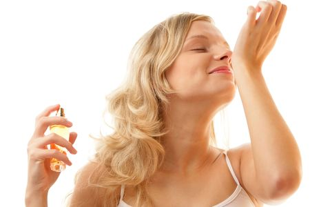 sniffing: Woman smelling perfume