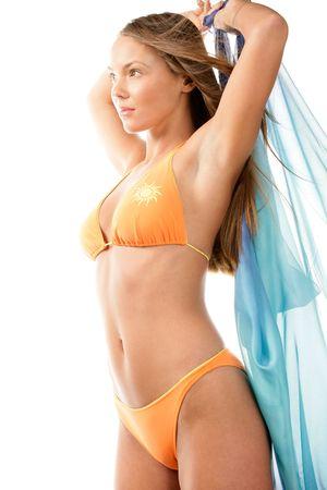 badpak: Bikini vrouw uitrekken Stockfoto