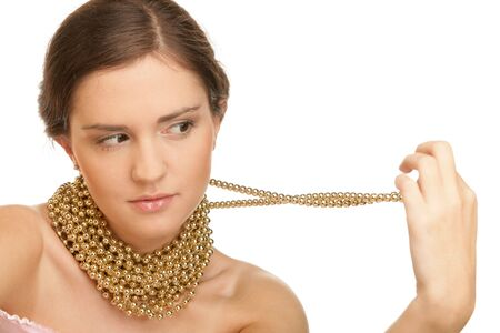 Woman wearing golden necklace photo