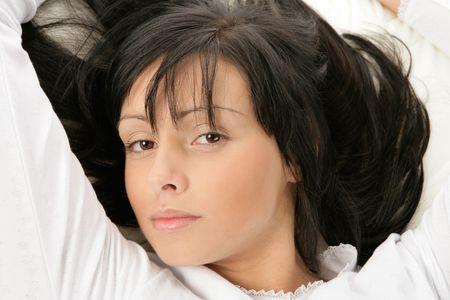 Beauty woman bedding photo