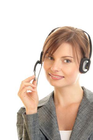 Portrait of friendly secretarytelephone operator wearing headset photo