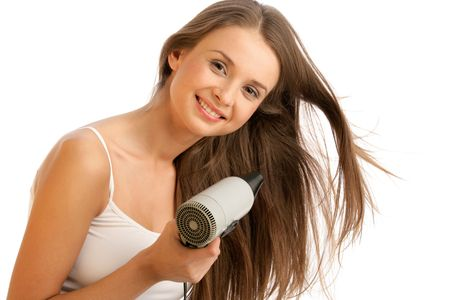 dryer: Young woman using hairdryer