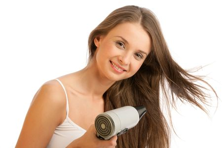 Young woman using hairdryer photo