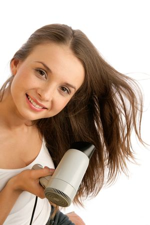 hair drier: Young woman using hairdryer