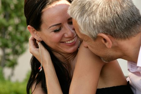 Close-up of Attractive happy couple laughing Stock Photo