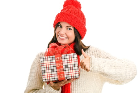 Pretty young woman with gift giving thumbs up  photo