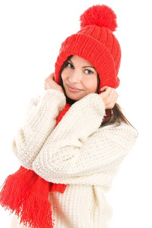 Woman wearing winter clothes covering ears with cap photo