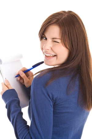 wink: Woman does records by pen in notepad Stock Photo