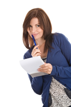 Woman does records by pen in notepad Stock Photo