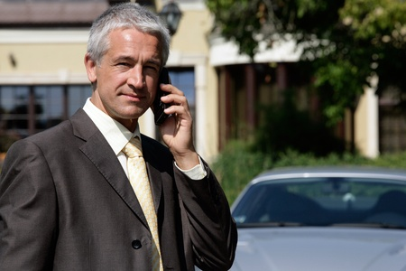 Businessman on cell phone photo