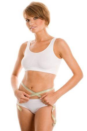 blonde underwear: Young beautiful woman measuring her waist